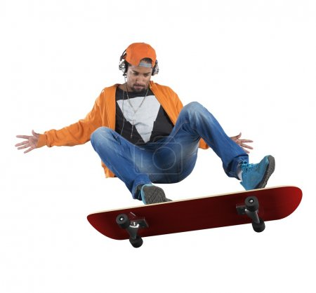 Photo for Street boy doing stunts with his skate - Royalty Free Image