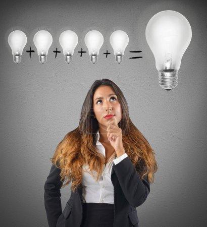 Businesswoman sum various ideas