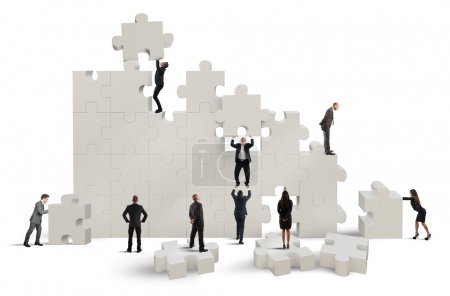 Photo for Business team working to build a puzzle - Royalty Free Image