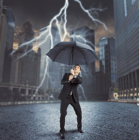 Businessman against thunder and lightning