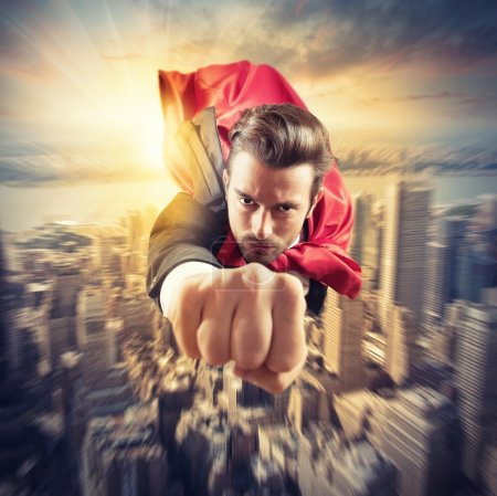 Photo for Businessman superhero flies fast in the sky - Royalty Free Image