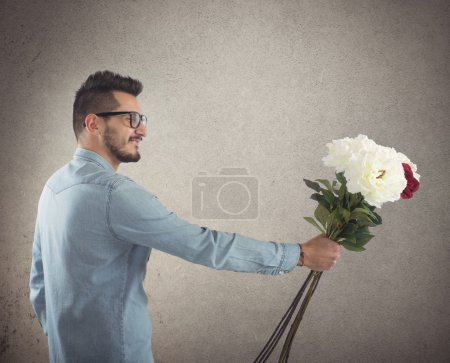 Nerd boy gives flowers