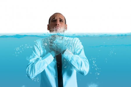 Photo for Desperate businessman with the water in the throat - Royalty Free Image