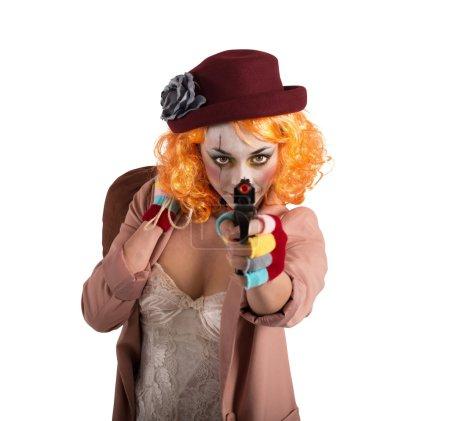 Thief clown aims with gun