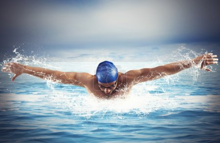 Man swimmer swims in open sea