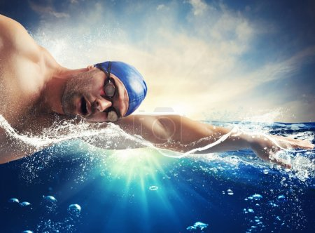 Photo for Swimmer swims in the sea in sunshine - Royalty Free Image