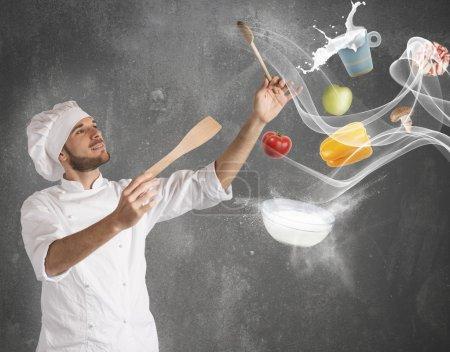 Photo pour Chef masculin crée une harmonie musicale avec la nourriture - image libre de droit