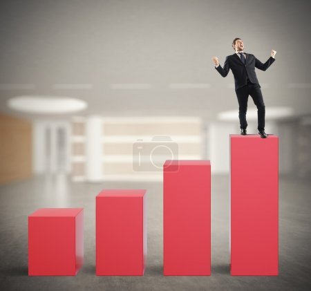 businessman on the top of a statistic bar