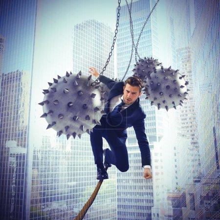 businessman balanced on rope