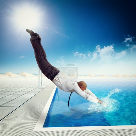 Businessman dives into the swimming pool
