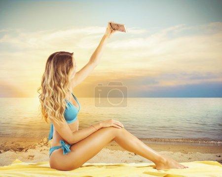 Bikini girl taking a selfie