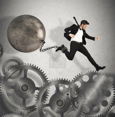 Businessman jumping  between gears