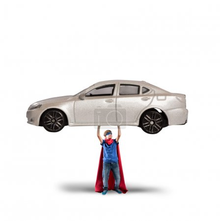 Photo for Superhero boy can lift a car with powers - Royalty Free Image