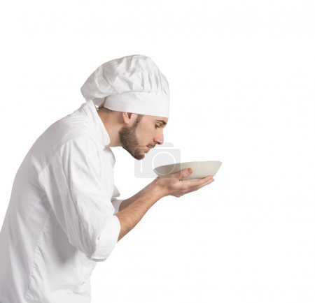 chef smelling the aroma of his dish