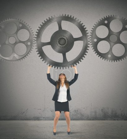 Businesswoman holding a gear