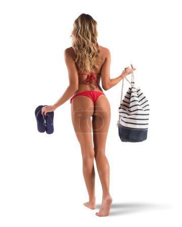 Bikini girl walking with bag