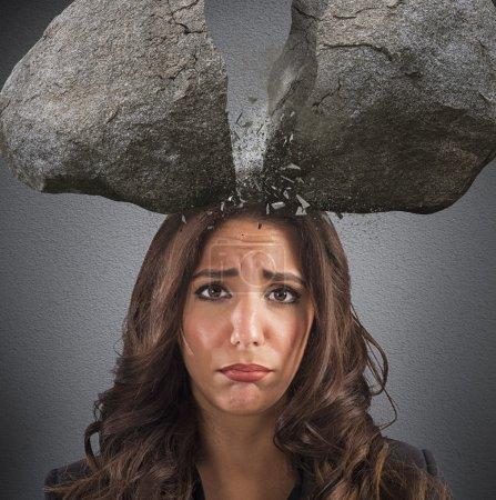 Businesswoman with split boulder