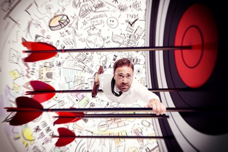 Photo for Businessman climbs to success on the arrow of target - Royalty Free Image