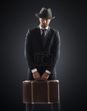 Elegant man with suitcase