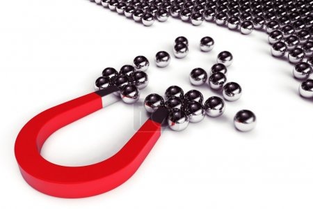 Magnet attracts steel balls