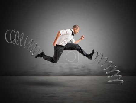 Businessman running  with the big springs