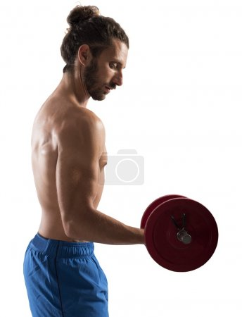 Man training biceps with dumbbell
