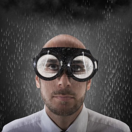 Businessman wearing glasses with wipers