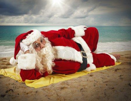 Santa claus relaxing at beach