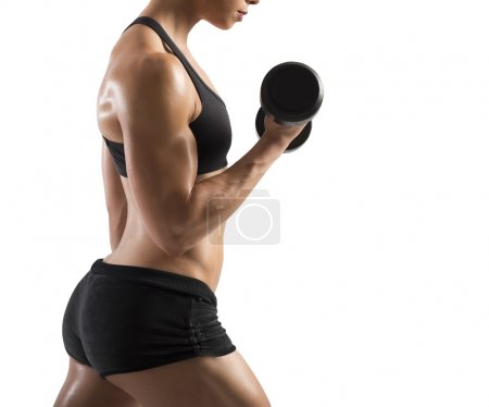 woman training biceps with dumbbells