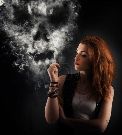 Girl smokes a cigarette