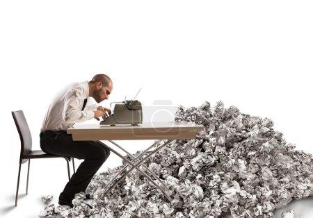 businessman writes with a typewriter