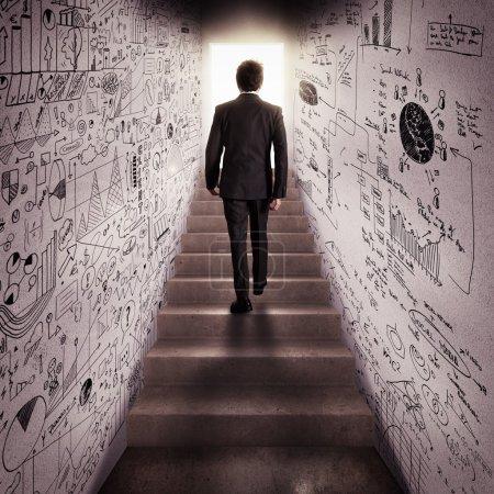 businessman climbs stairs
