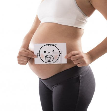 Pregnant woman holds card
