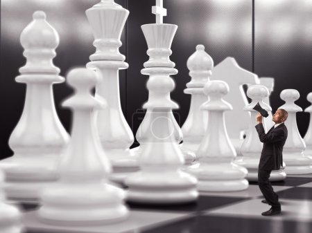 Businessman yelling to chess piece