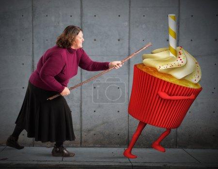 Fat woman hit a cupcake