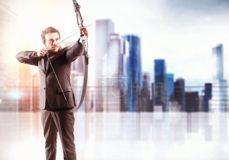 Photo for Businessman with bow pointing a target and city view background - Royalty Free Image