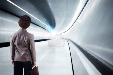 Kid walks in futuristic tunnel