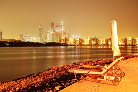 Night illumination of the luxury hotel on Palm Jumeirah man-made island, Dubai, UAE