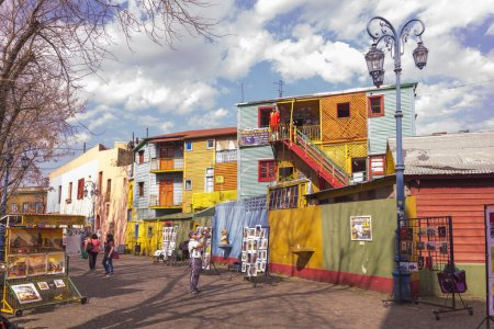 Photo for BUENOS AIRES, ARGENTINA - AUGUST 21, 2014: Historical tenement house and paintings for sale at Caminito street on August 21, 2014 in La Boca, Buenos Aires, Argentina. Nowadays functions as a complex of shops and bars. - Royalty Free Image