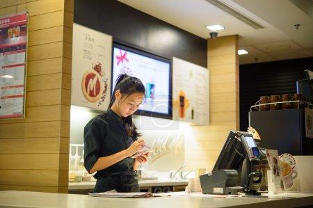 SHENZHEN, CHINA - DECEMBER 21, 2015: barista in Mc...