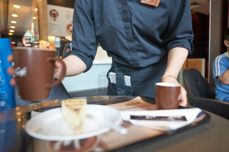 barista bring order at McCafe