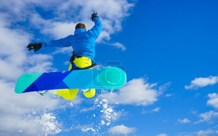 Young man on the snowboard