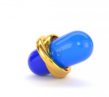 Wedding gold rings and medical capsule isolated on white backgro