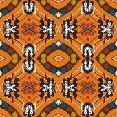 Seamless background from a floral ornament orange tribal style.