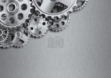 Photo pour Roues de transmission en acier sur fond métallique - image libre de droit