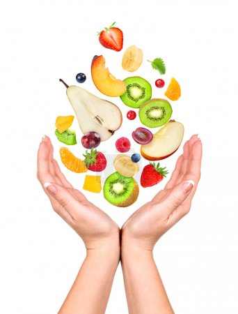 Photo for Concept: slim figure in your hands. Different fruits and berries fall in the opening  hands - Royalty Free Image