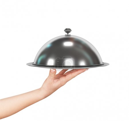 Photo for Close up hand of waiter with metal cloche lid cover and tray - Royalty Free Image