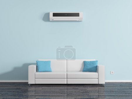 Air conditioning on the wall above the sofa cushio...