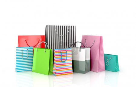 A set of colored paper bags on a white background.