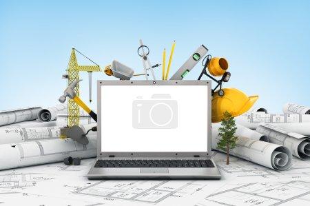 Photo pour L'ordinateur portable avec écran vide et objet pour la construction. Bleus et un casque de sécurité au-dessus d'une table en chantier. - image libre de droit